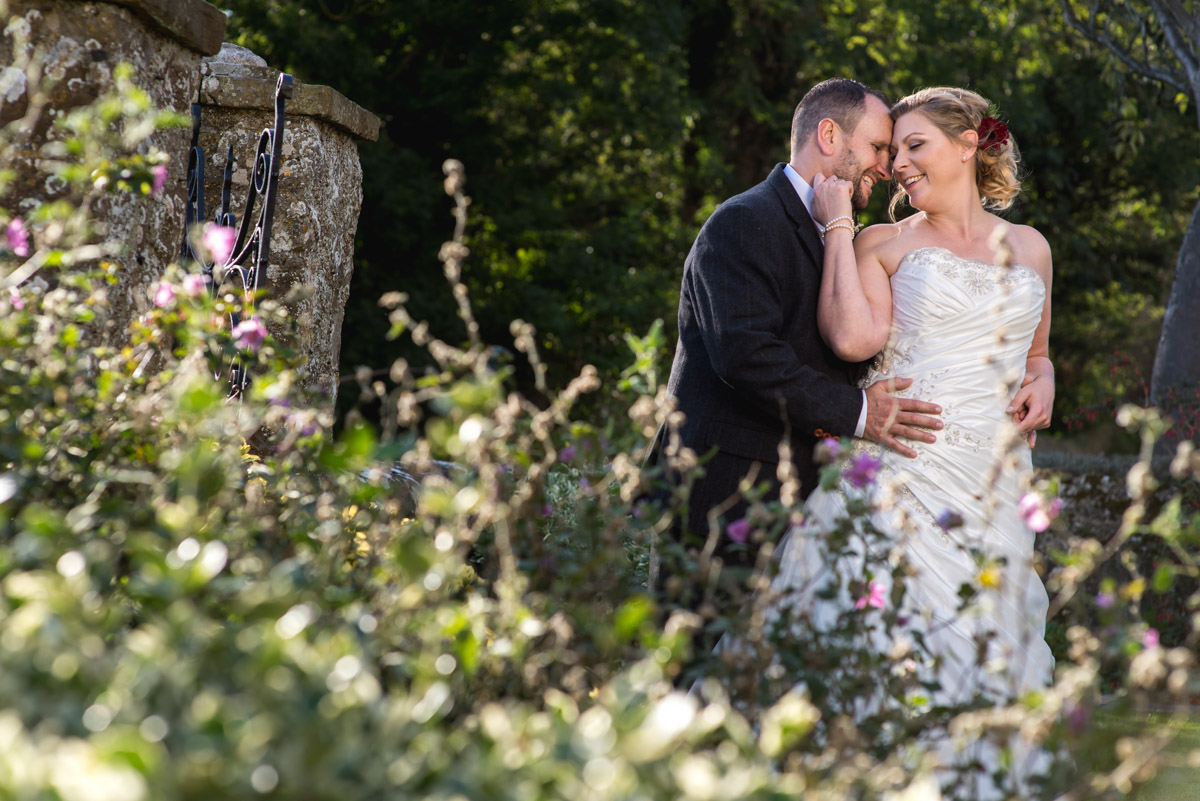 Photograph of John and Lianne in the grounds at Lympne Castle during their wedding day