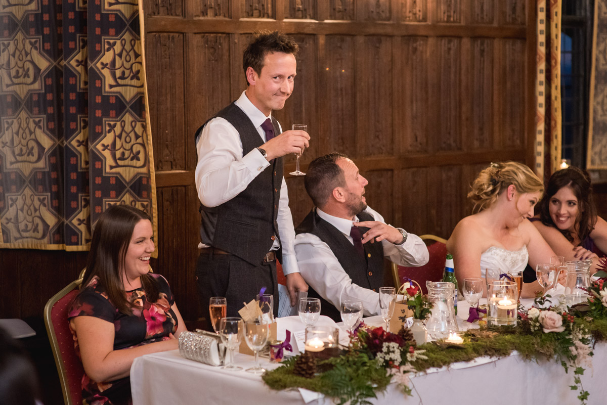 Johns best man makes his wedding speech during their reception at Lympne Castle in Kent