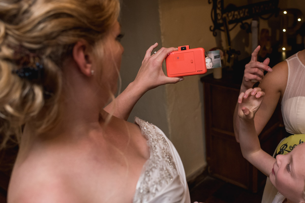 Lianne is photographed on her wedding day taking a selfie