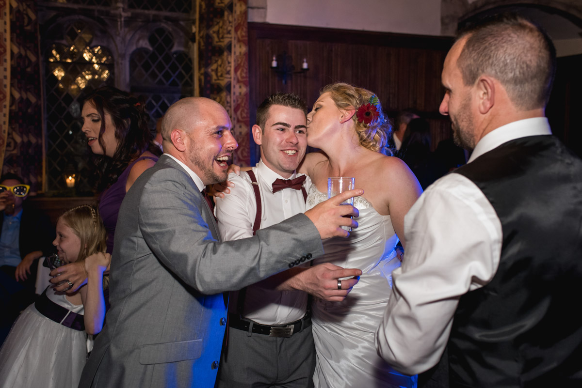 Guest and John and Lianne photographed on the dance floor during their wedding reception at Lympne Castle in kent