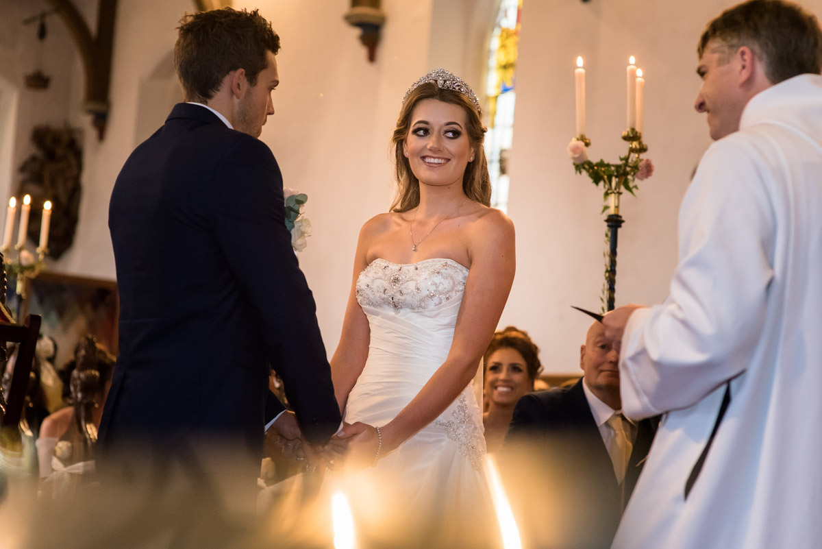 Photograph of Jade and Stuart during their Kilndown church wedding ceremony in Kent