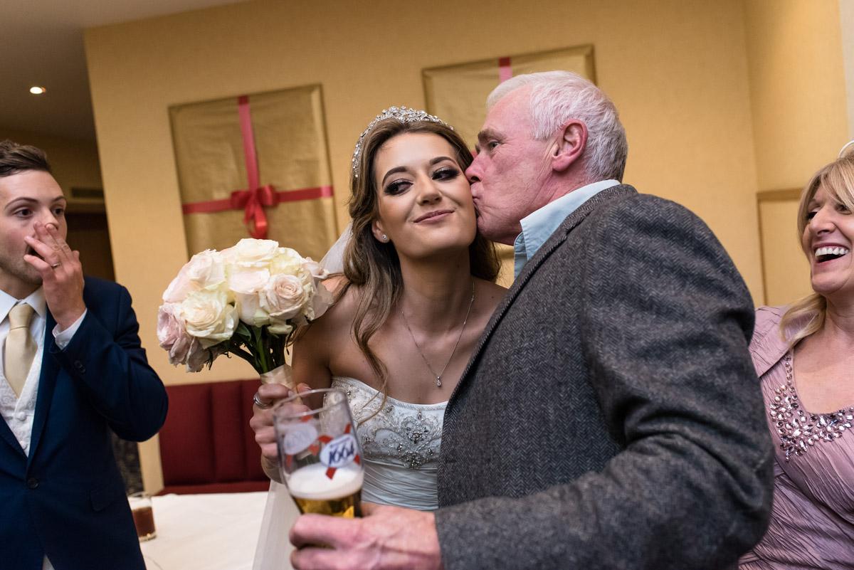 Wedding guests kisses Jades cheek