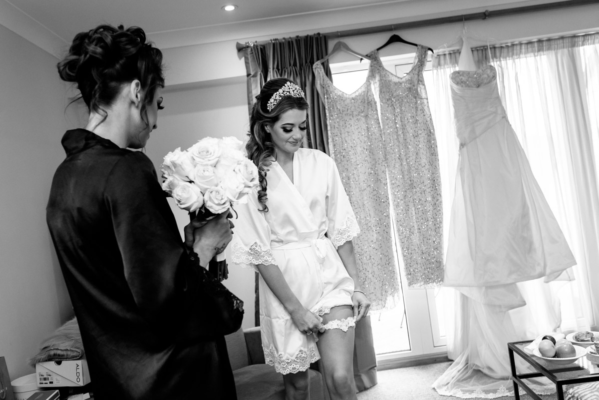 Jade is photographed putting on her garter on her wedding day in Kent