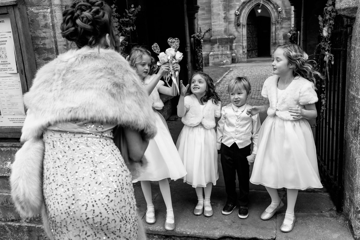 Black and white photograph of the flower girls and page boy at Jade and Stuarts Kilndown Church wedding in Kent