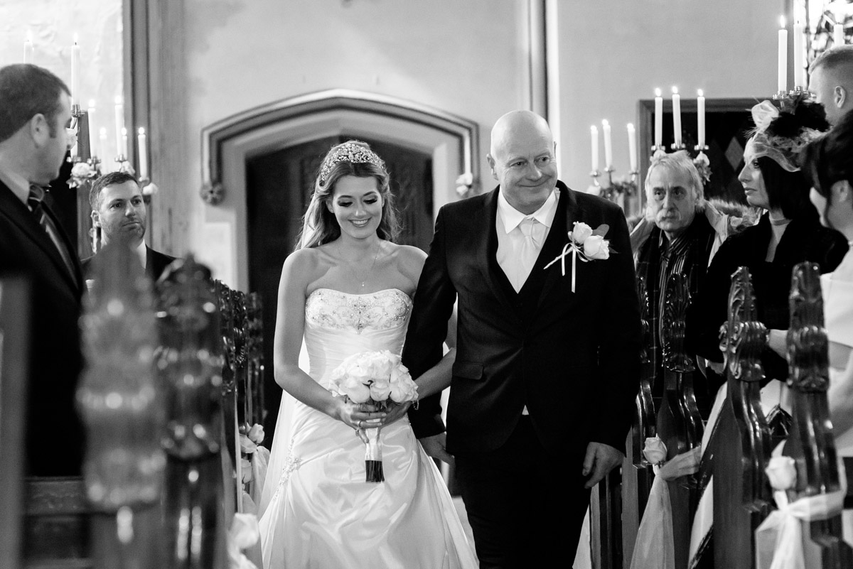 Jade is photographed walking up the aisle with her father at her Kilndown church wedding in Kent