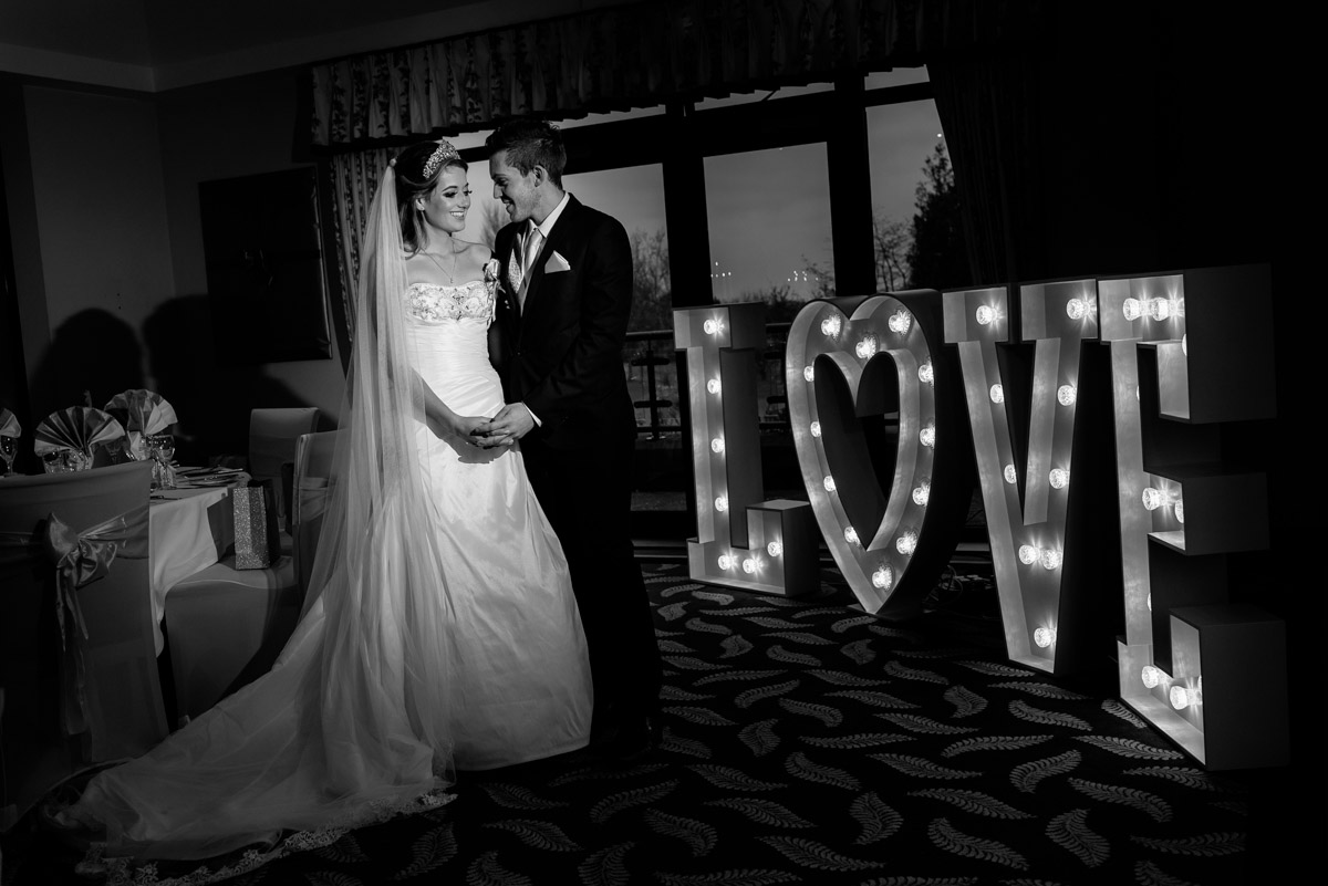 Black and white wedding photograph of Jade and Stuart at Dale Hill Golf Club