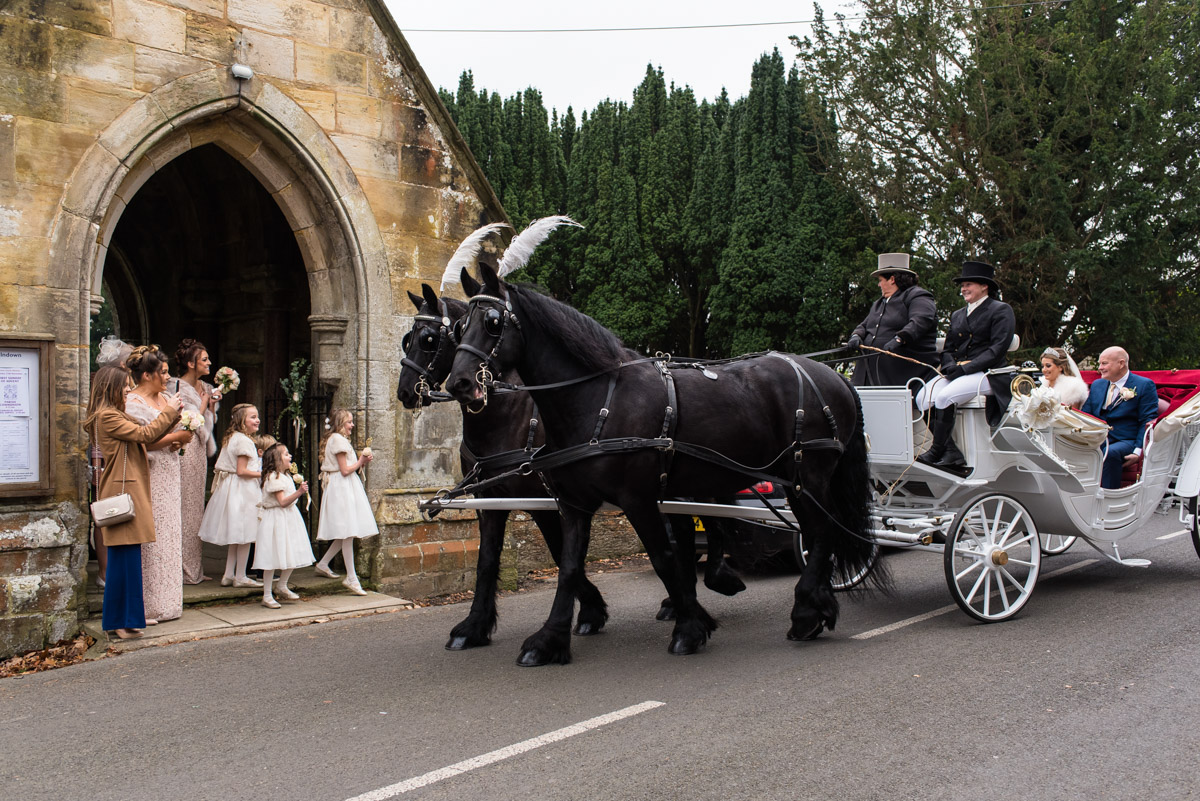 Photograph of Jade arriving for her church wedding in Kent in horse drawn carriage