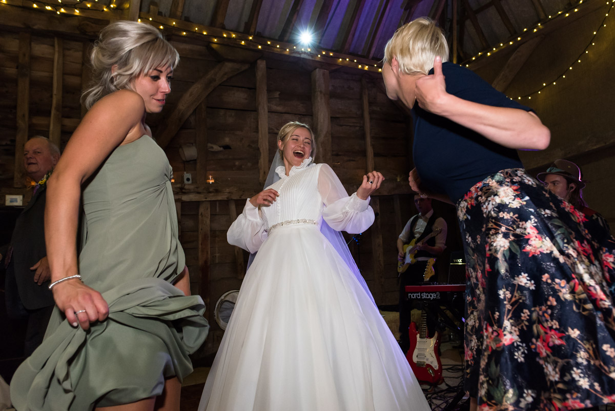 Photograph of Jane dancing at her Chilham church wedding reception