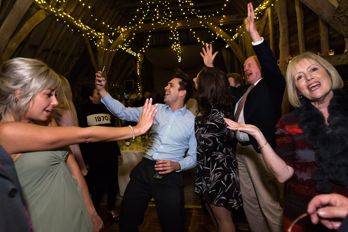 Guests enjoy the wedding dancing on Jane and Stevens chilham church wedding day in Kent