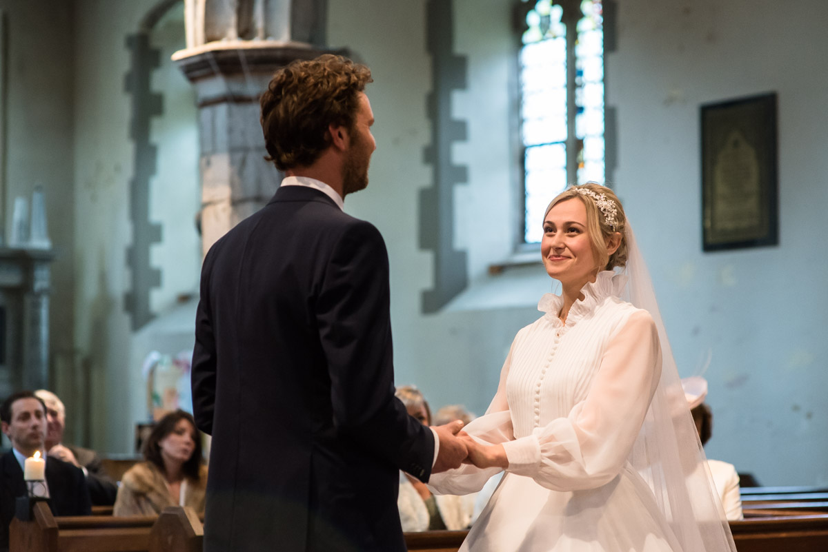 Photograph of Steven and Jane in Kent church taking their wedding vows
