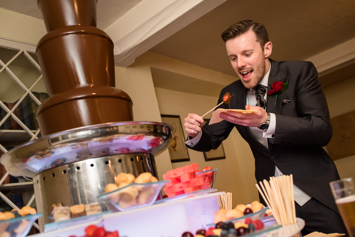 Enjoying the chocolate fountain at Sue and Nicks wedding reception