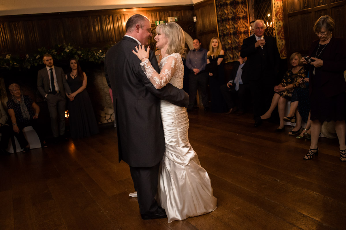 Nick and Sue are photographed doing their first dance at their wedding reception at Lympne castle in Kent
