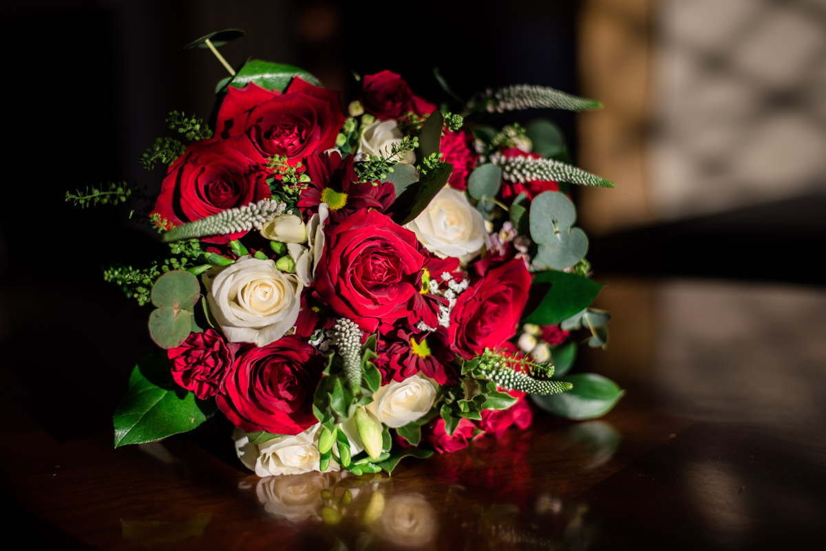 Photograph of Sue's wedding bouquet of red and white roses
