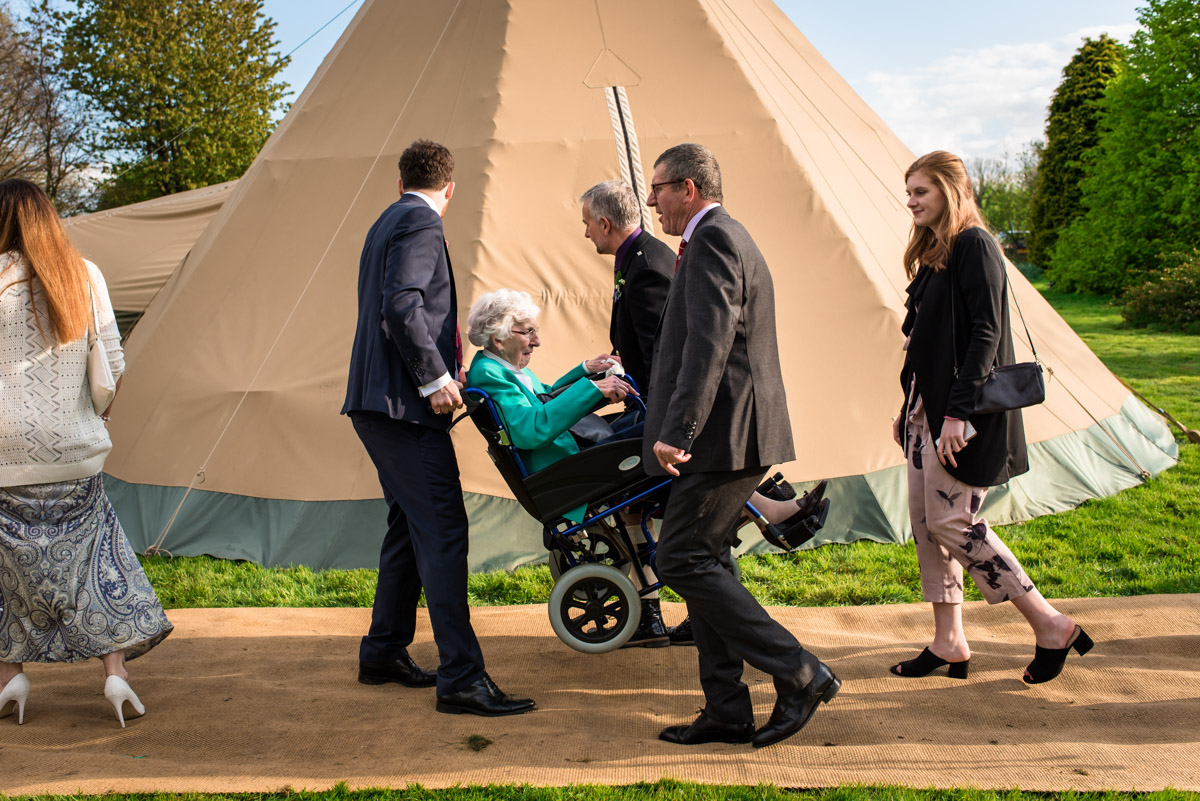 Photograph of gran being carried to wedding reception