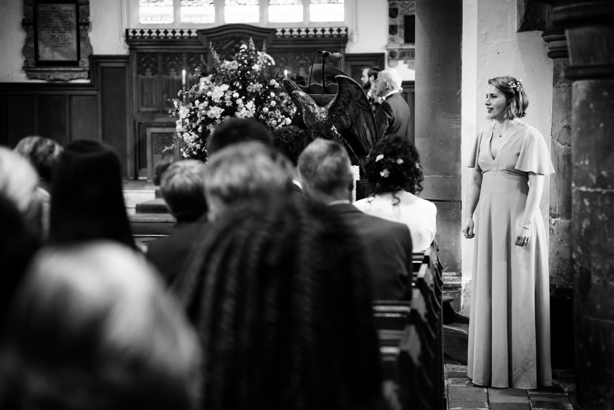 Alice is photographed singing at her sister Brenchley church wedding in Kent