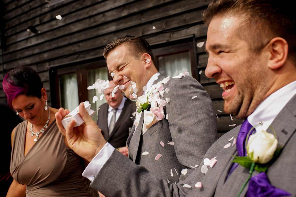 Photograph of Nick having confetti thrown in his face at his Old Kent barn wedding