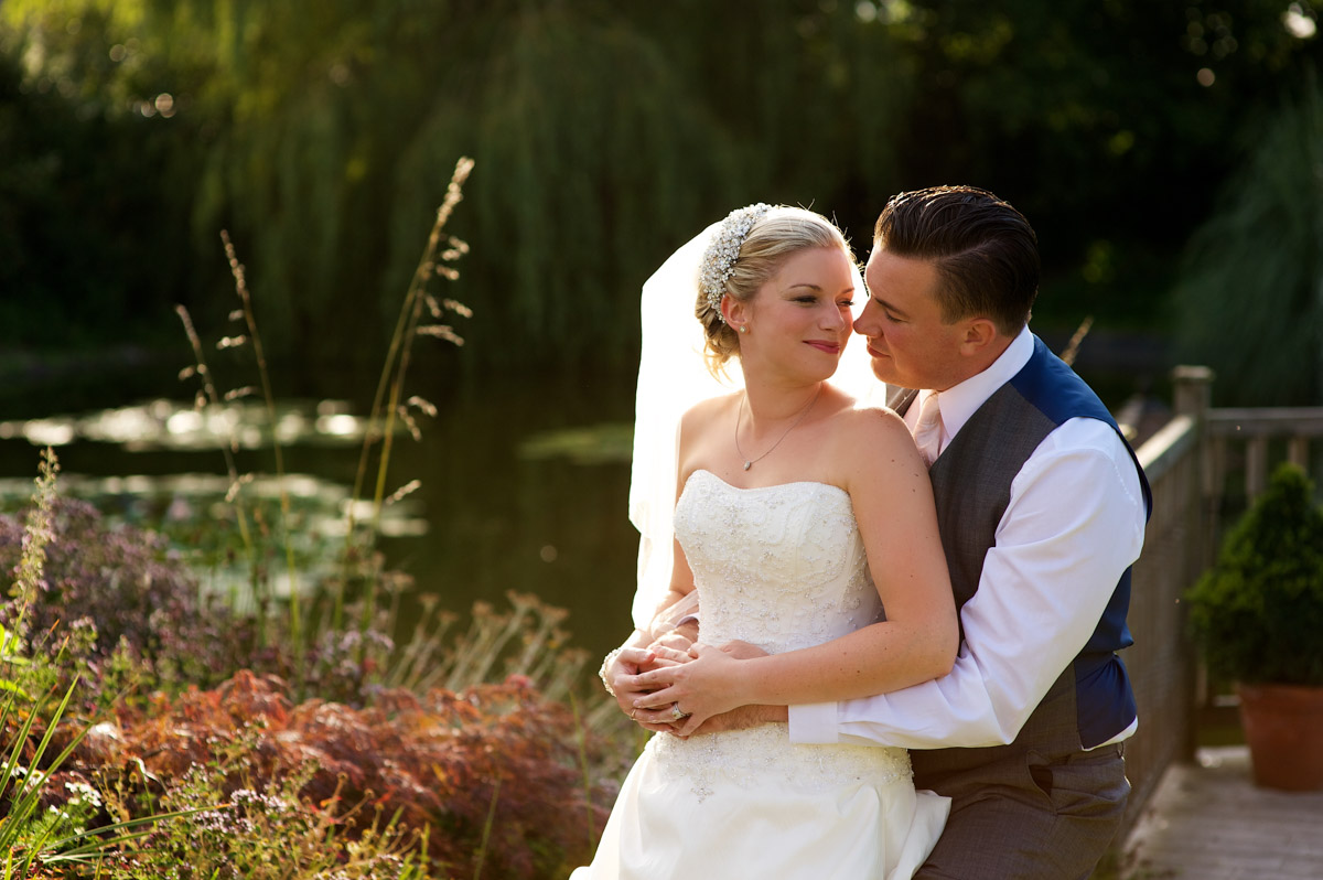 Photograph of Emma and Nick by the water feature at the Old Kent barn
