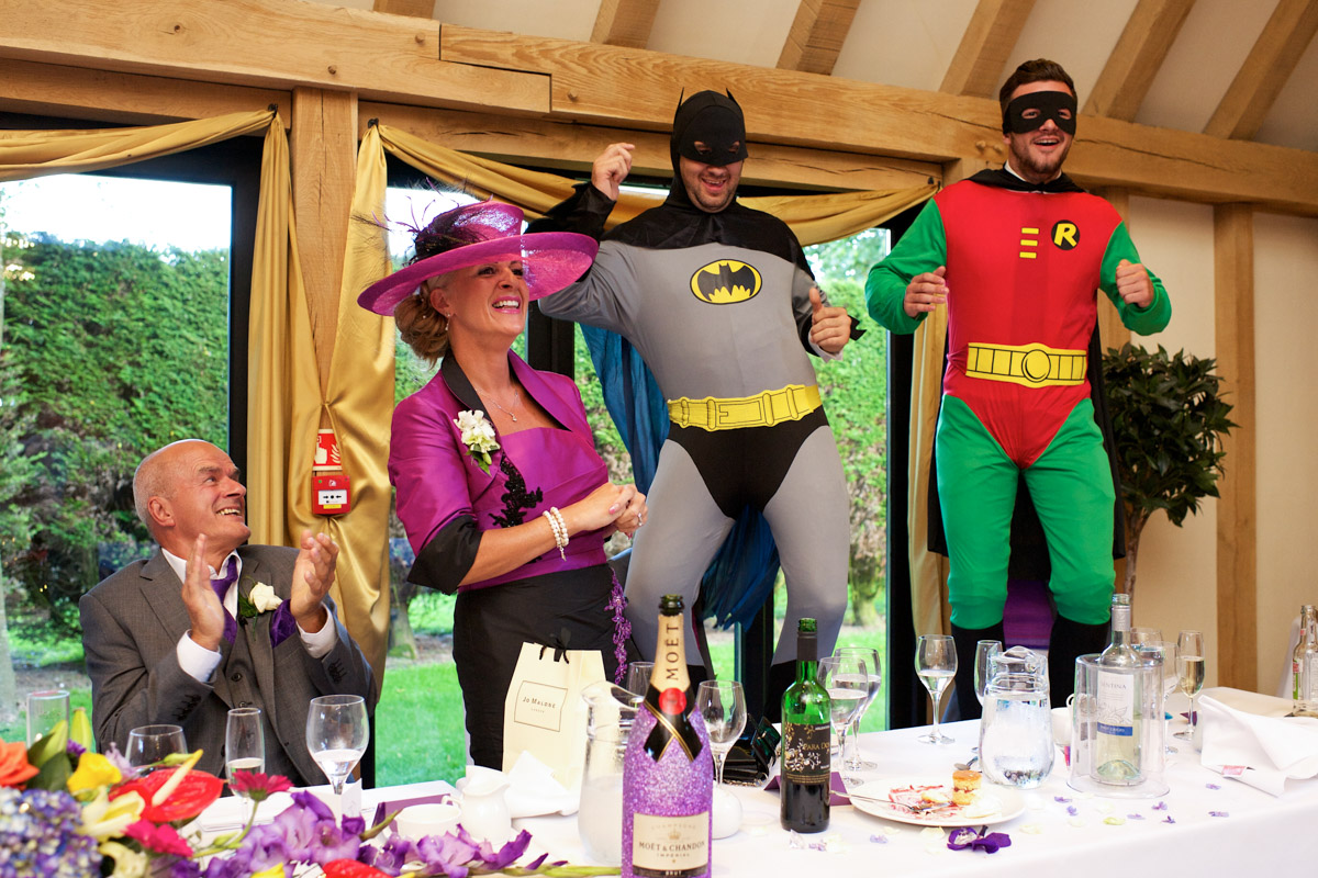 Best men dressed as Batman and Robin during wedding speeches