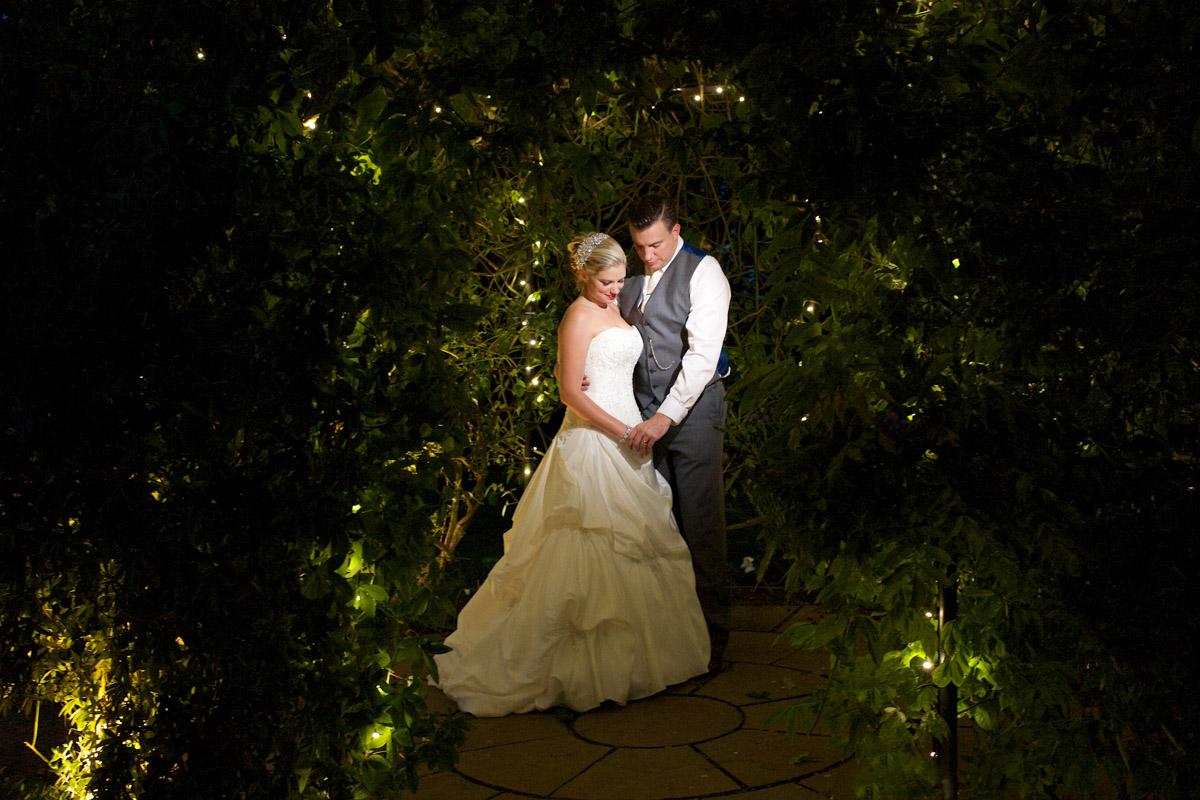 Emma and Nick photographed under fairy lights at the Old Kent barn wedding