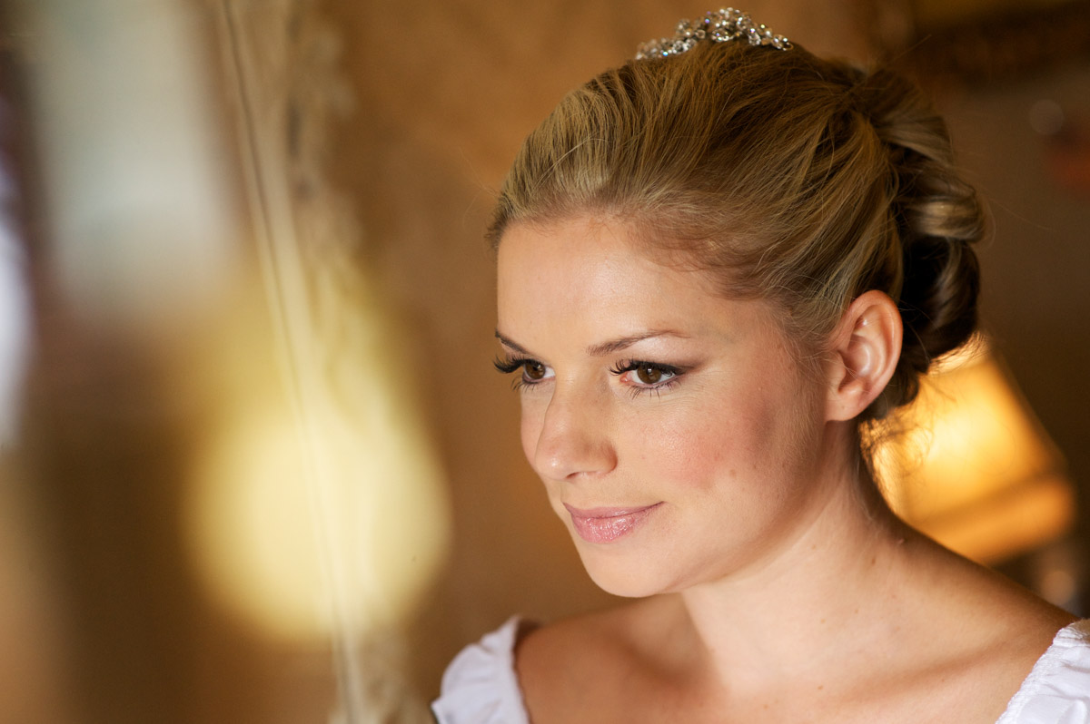Photograph of Emma having wedding makeup done at The Old Kent barn