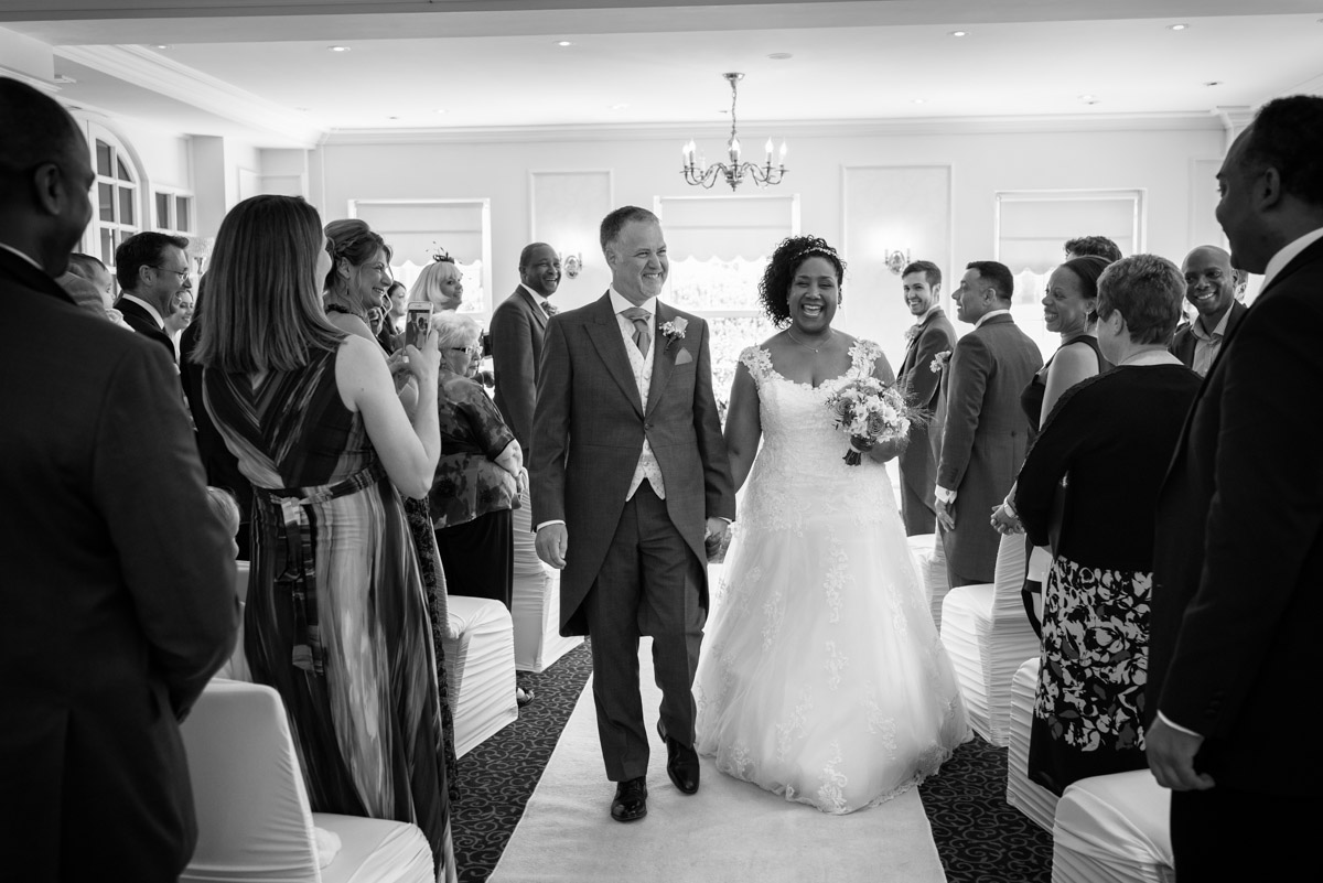 photograph of darren and Juliette after their wedding ceremony at The Hythe Imperial in Kent