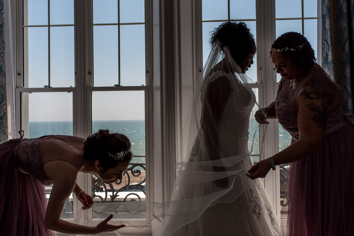 Photograph of Juliette and bridesmaids getting ready for her Kent wedding at The Hythe Imperial