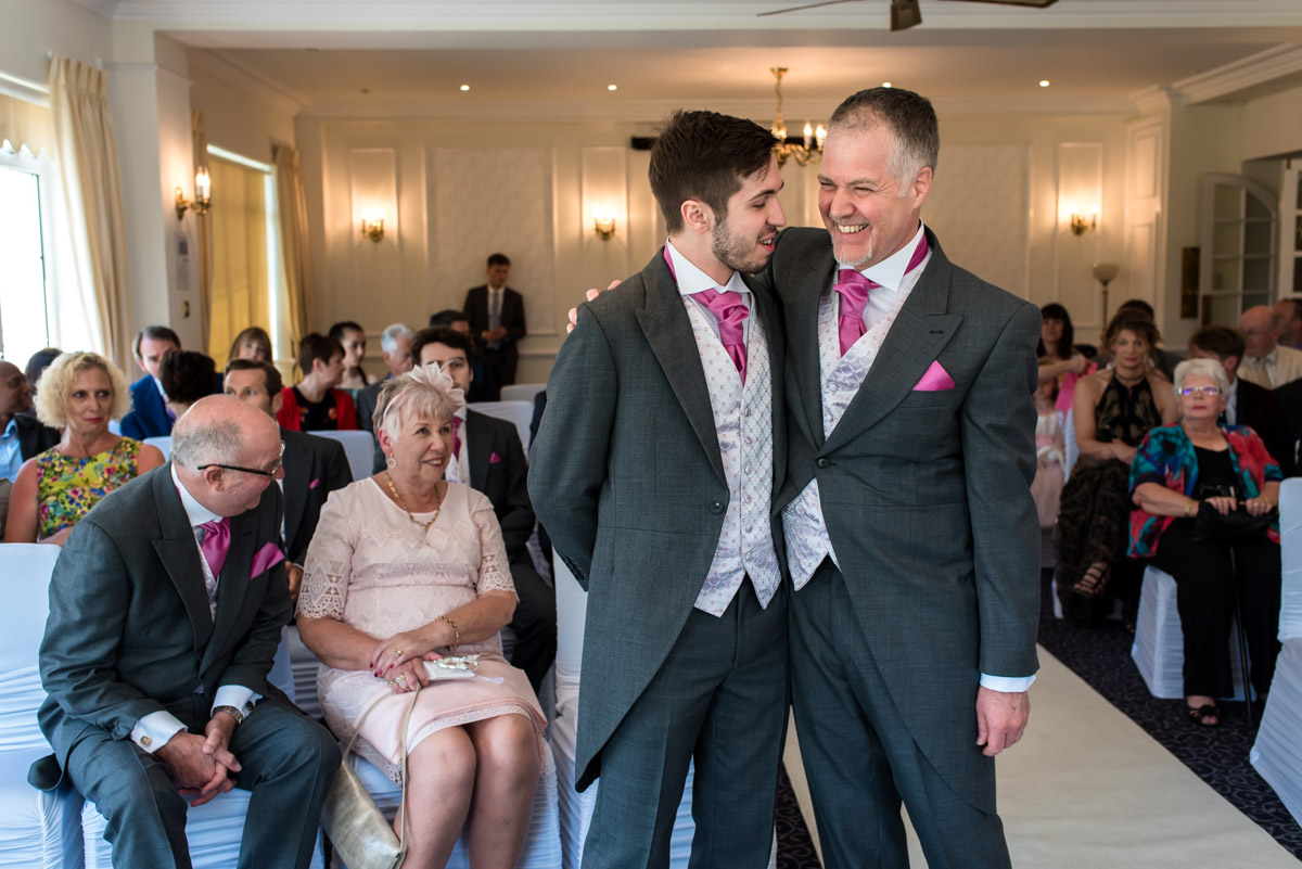 Darren and his son photographed before his Hythe Imperial wedding ceremony