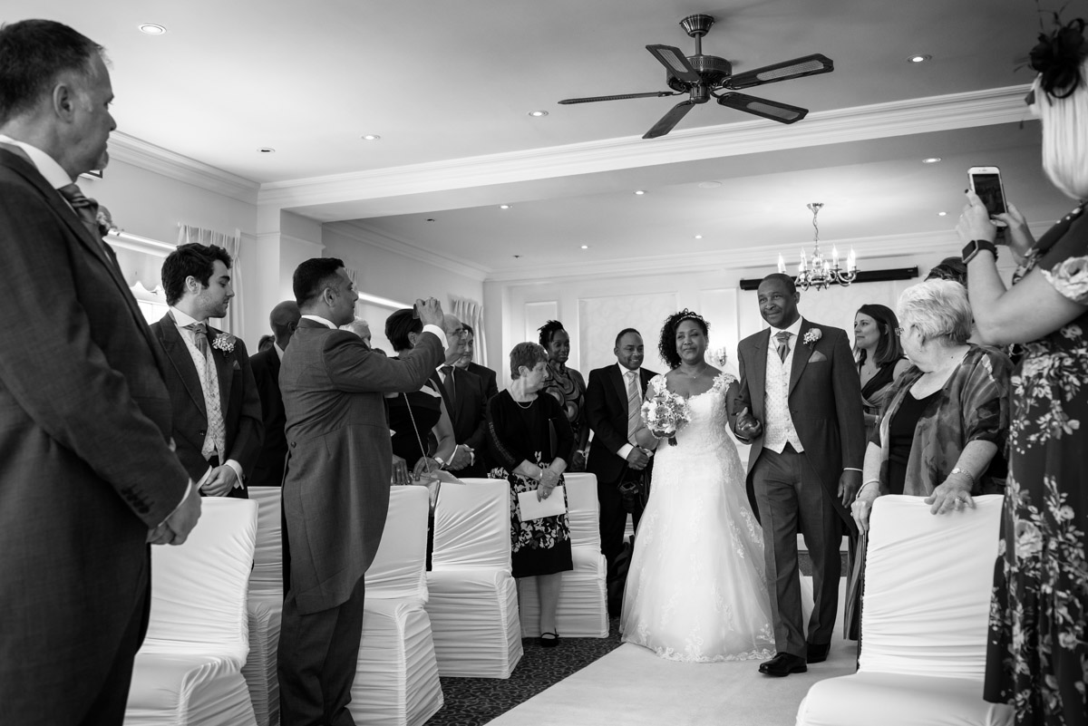 Juliette photographed escorted by her brother down the aisle