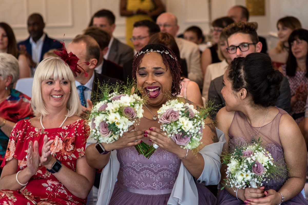 Bridesmaid photographed holding wedding bouquets during Hythe Imperial wedding