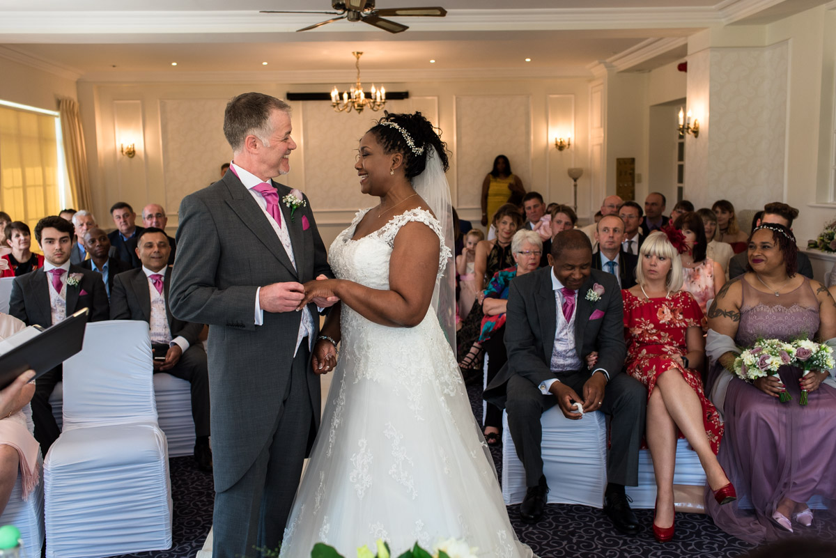 Photograph of darren placing wedding ring on Juliette during Hythe Imperial ceremony