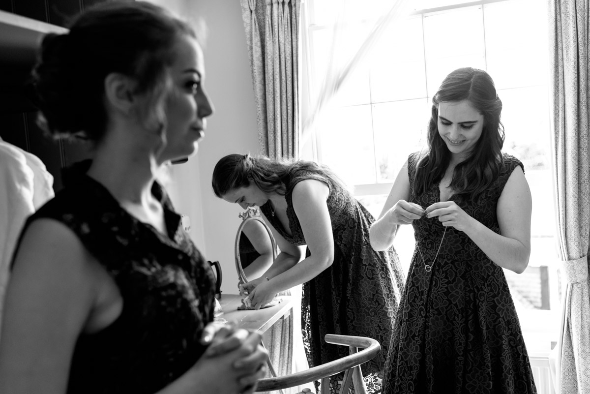 Bridesmaids getting ready for Beth & Toms Ratsbury Barn wedding in Kent
