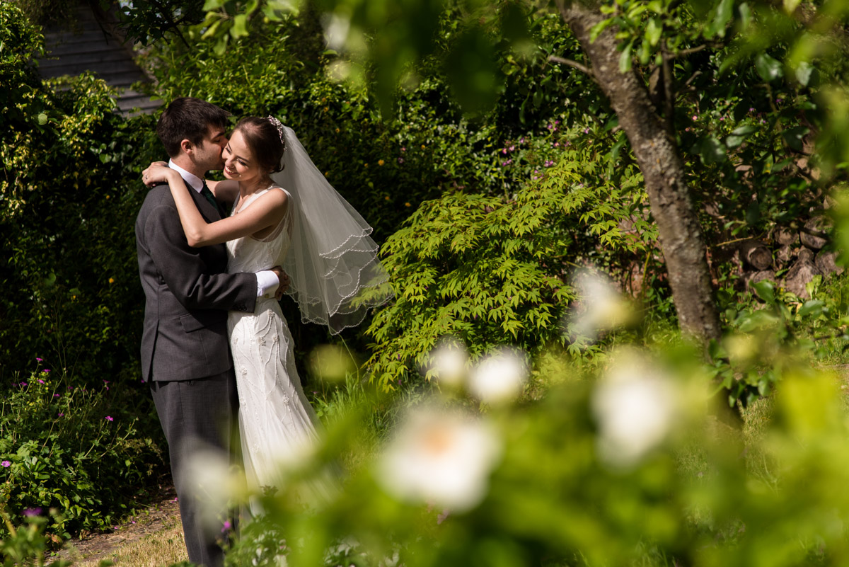 Beth and Tom photographed in the gardens at Ratsbury Barn in Kent