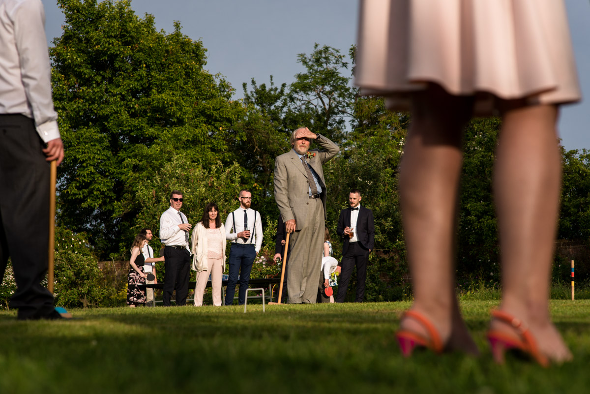 Wedding guests play croquet at Ratsbury Barn in Kent