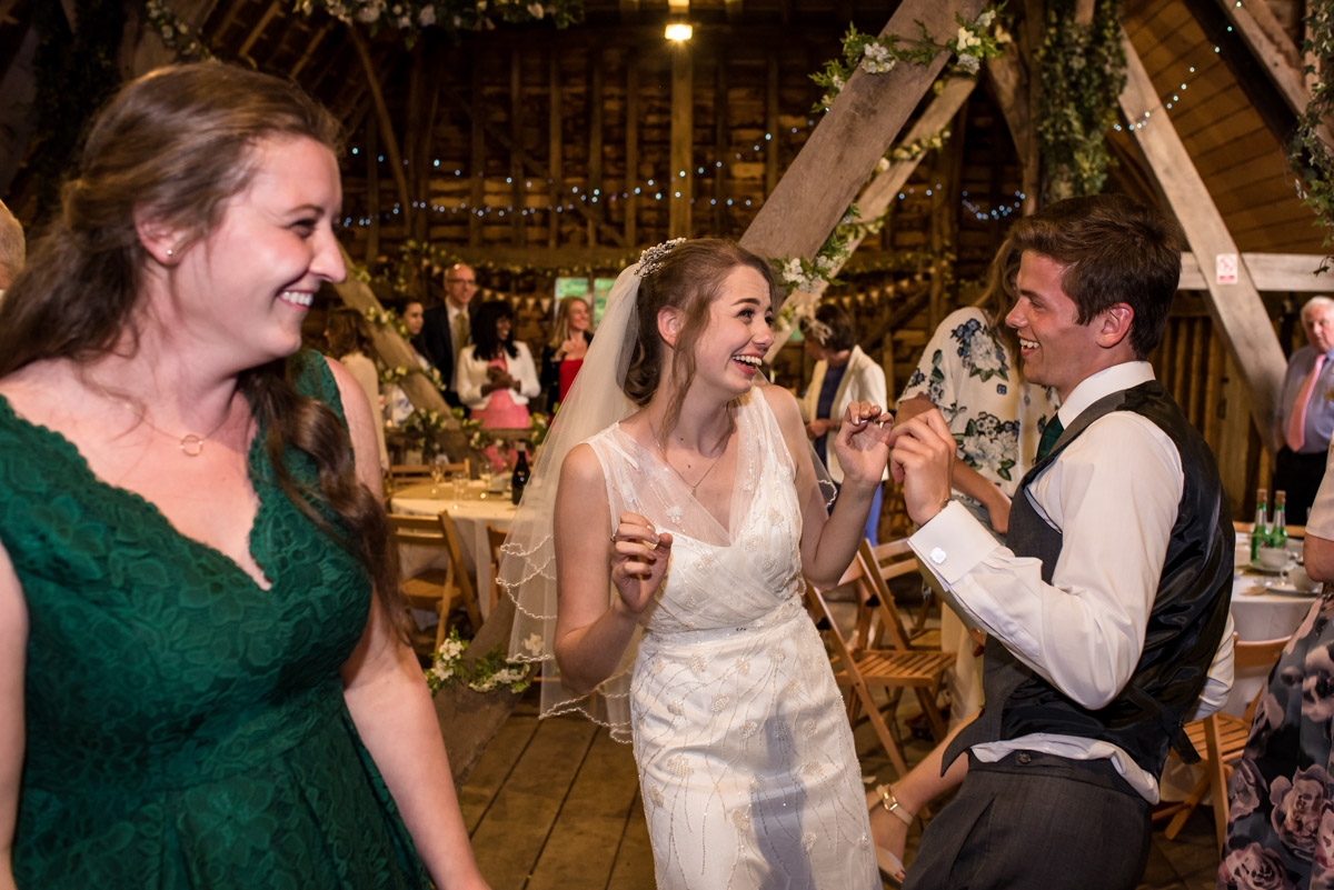 beth and her brother dancing at her wedding at Ratsbury barn
