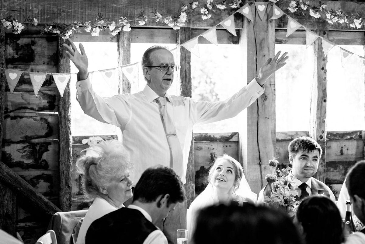 Blacka nd white photograph of brides father making his wedding speech