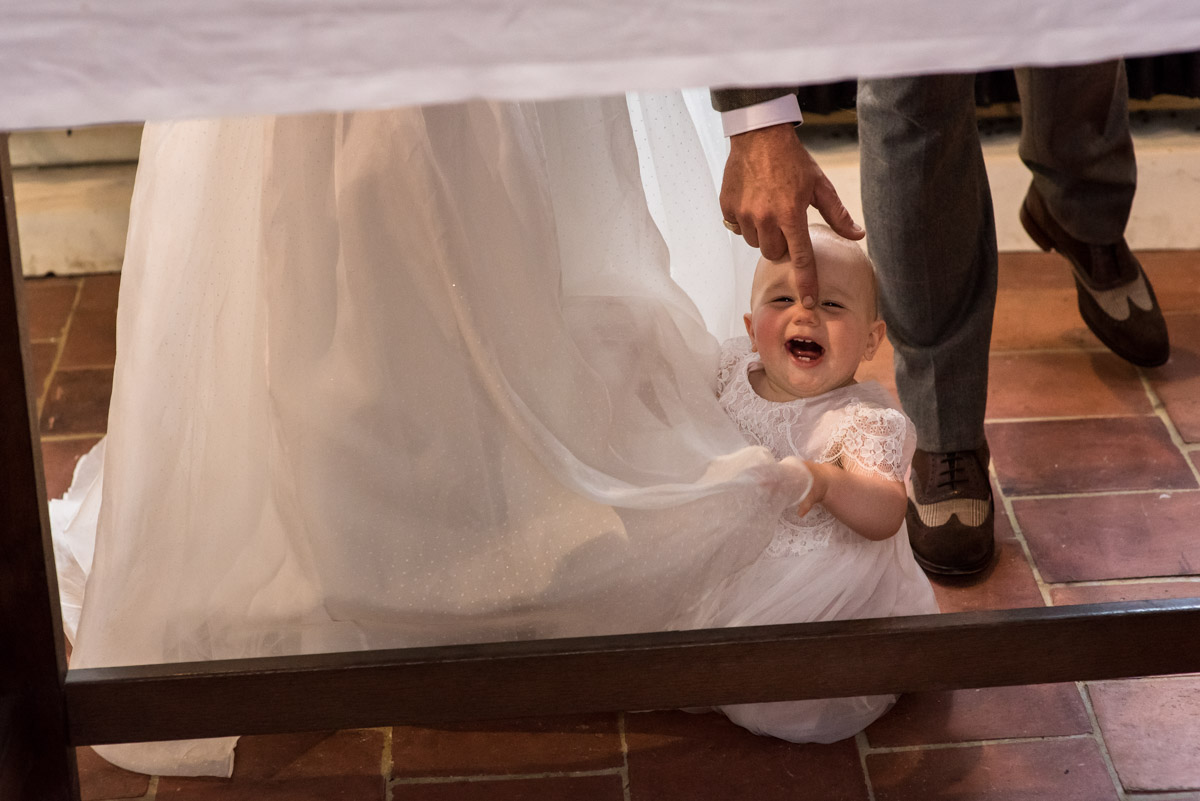 baby is photographed during Kent wedding during signing of the register