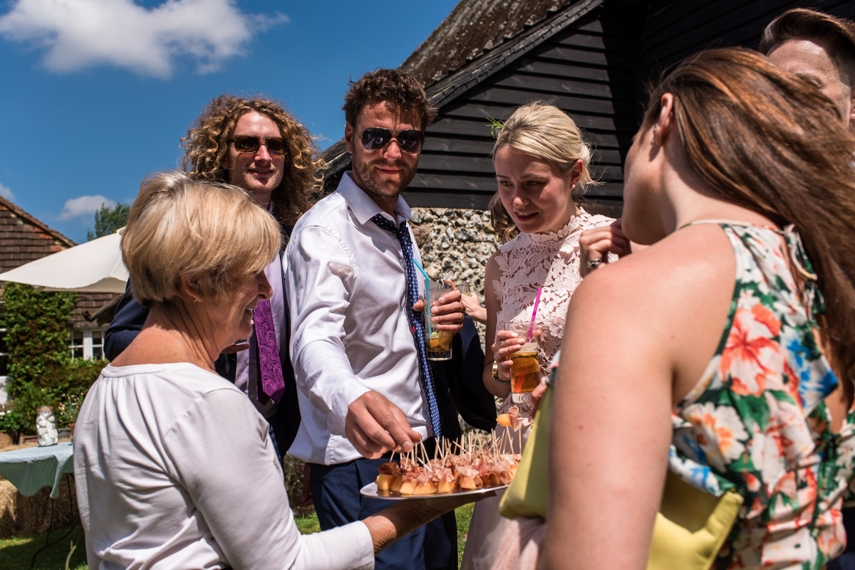 Photograph of Anne and Joshs wedding guests enjoying canapés