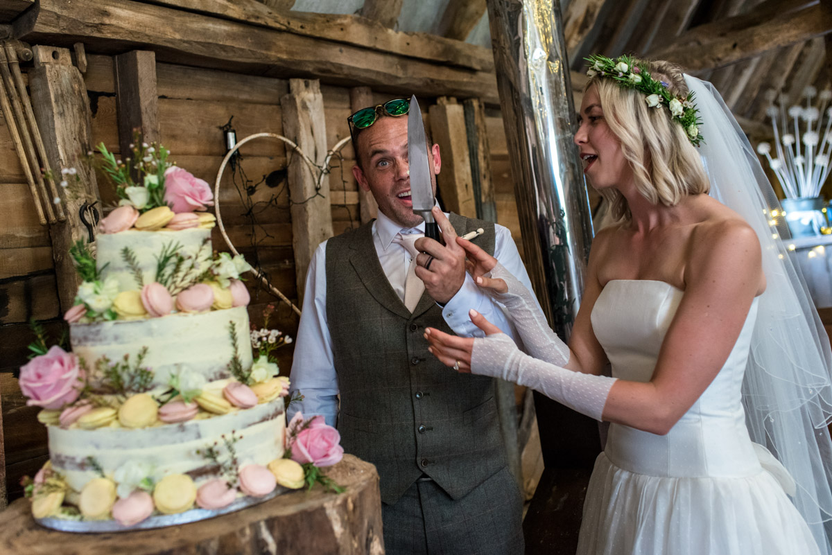 Anne and Josh photographed cutting their wedding cake