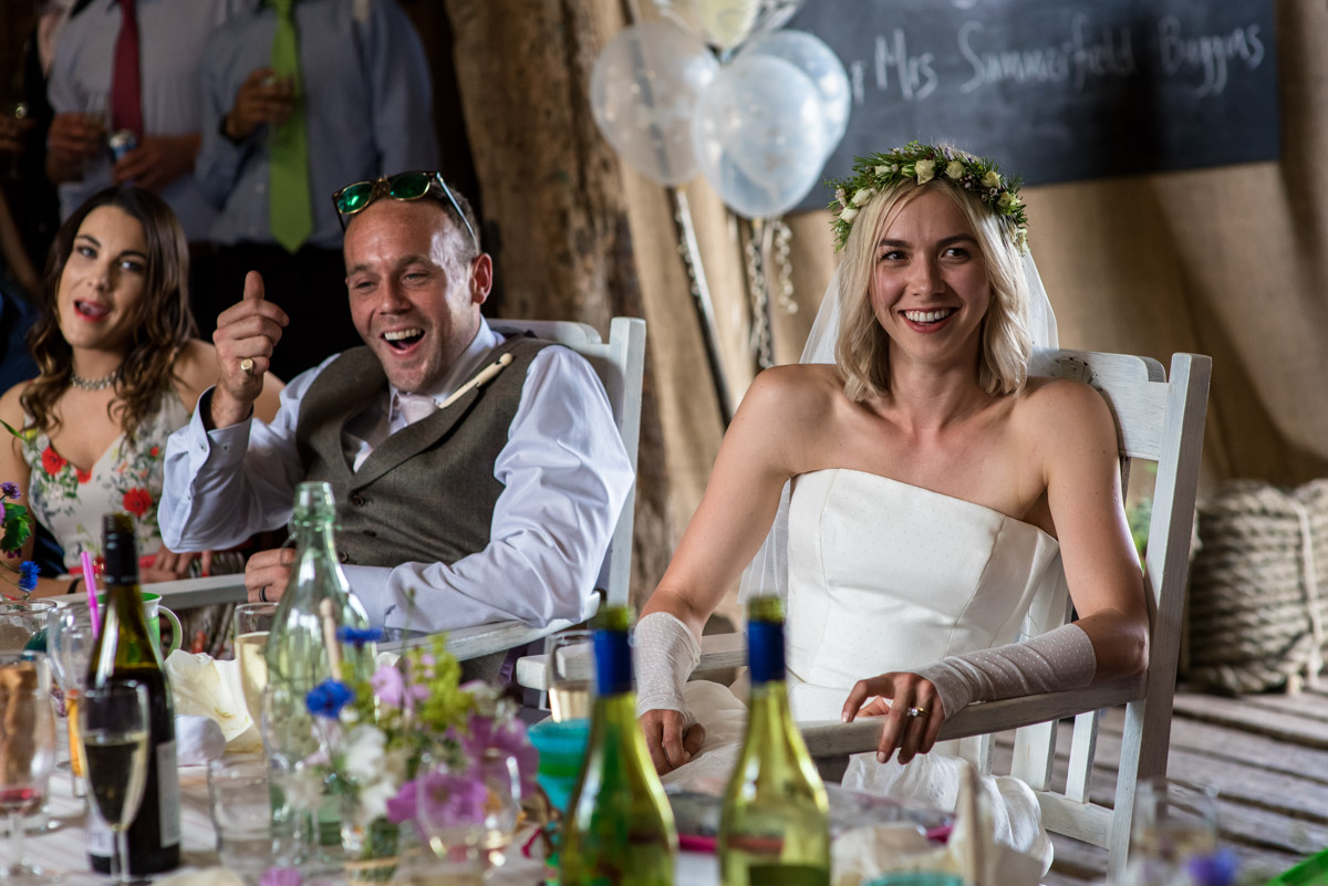 Josh and Anne are photographed during reception speeches at their Kent wedding