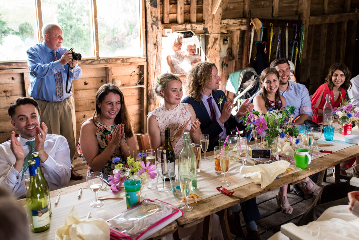 Photograph of wedding guests during reception at Josh and Annes Kent barn reception