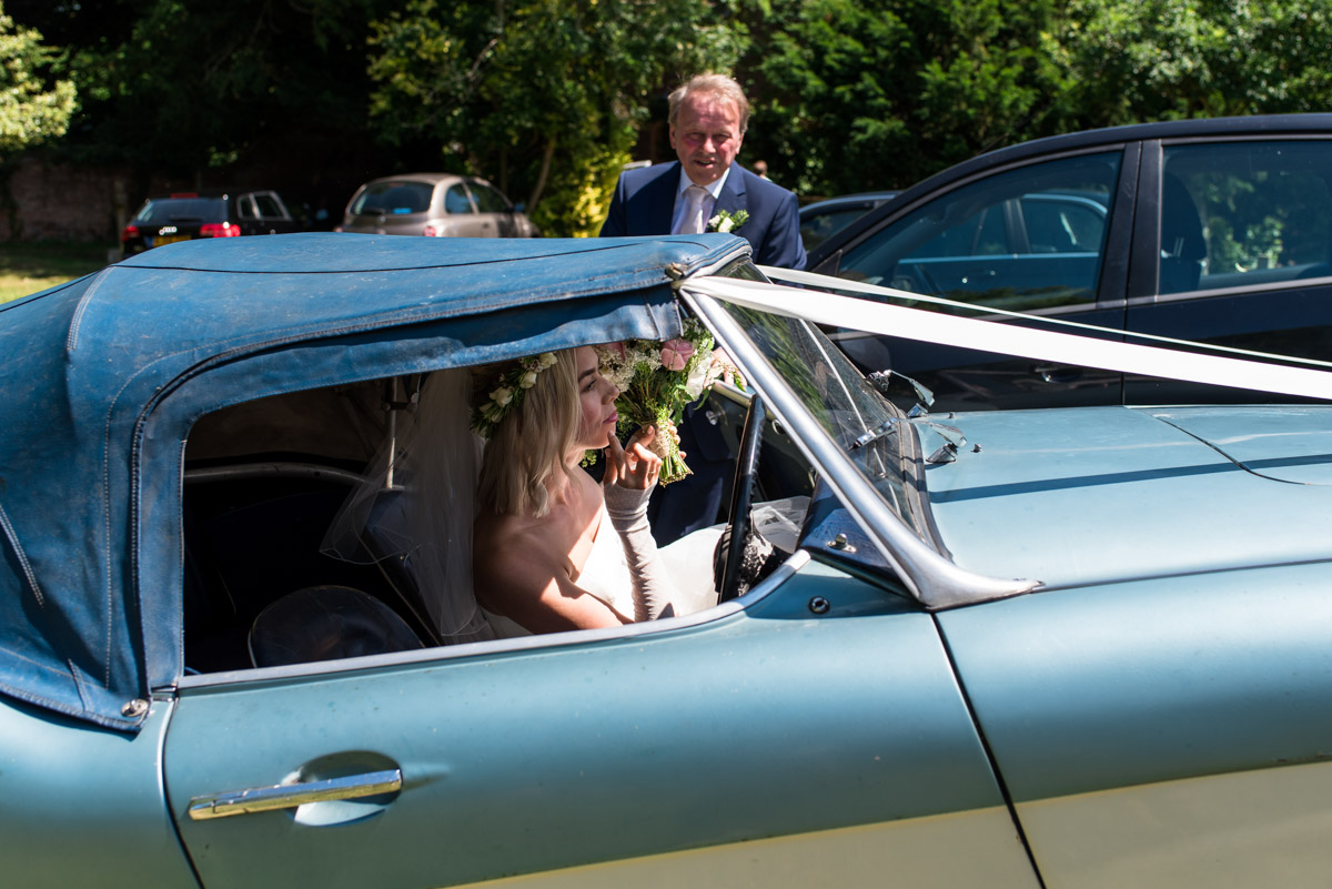 Anne arrives for her Kent church wedding in classic car