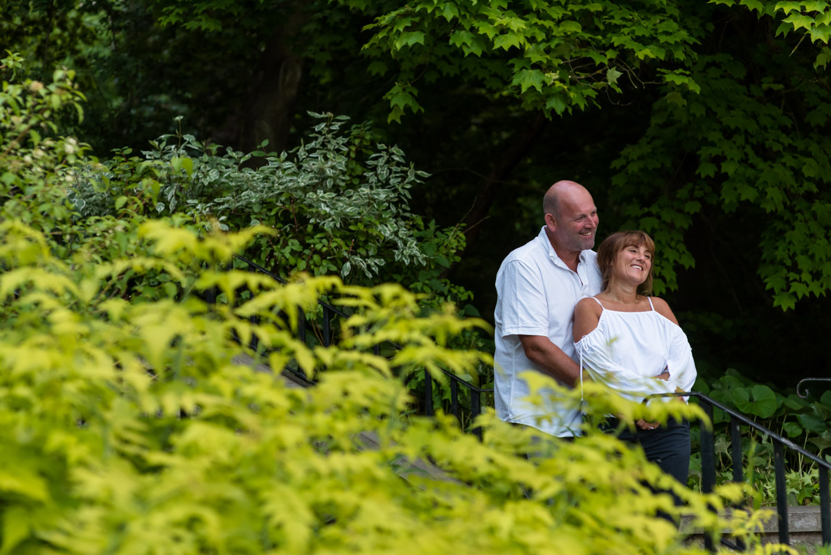 Debbie and Martin photographed together on the steps at Moat park during their pre wedding photography shoot
