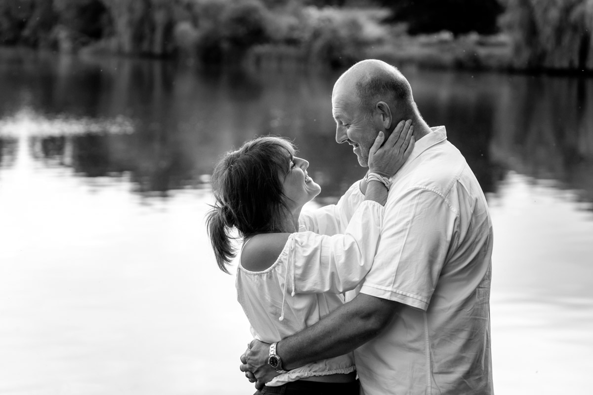 debbie holds Martins face in her hands during their pre wedding photography at Moat park in Kent