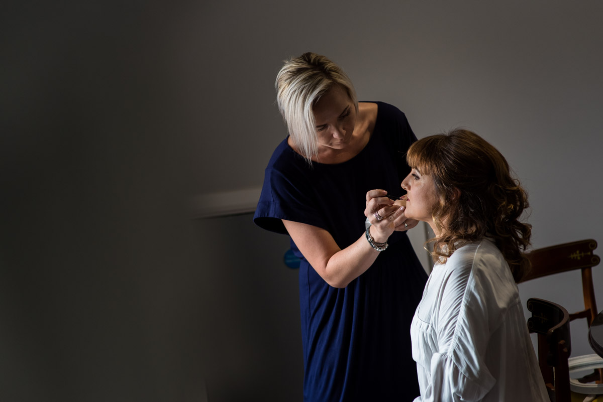 Photograph of debbie having her make up done at The Gardnes balding wedding venue