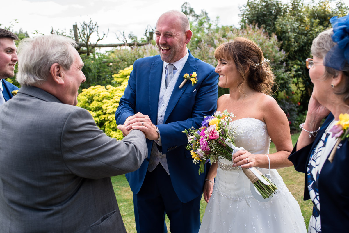 Photograph of Debbies father and Martin after their outdoor wedding at The Gardens Yalding