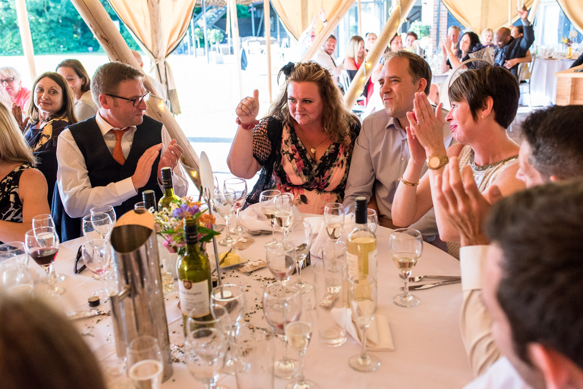 Photograph of wedding guests inside tipis at The Gardens Yalding