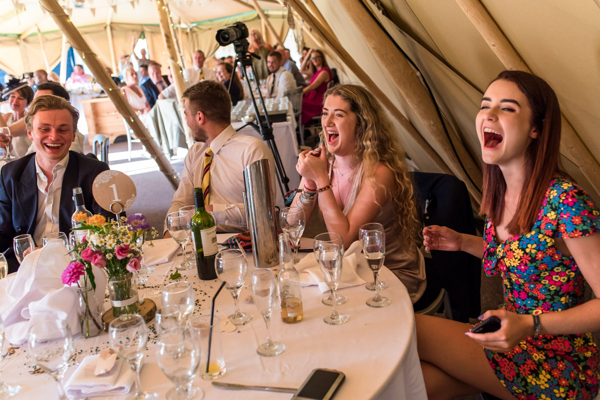 Guests enjoying the speeches at Martin and Debbies wedding at The Gardens Yalding in Kent