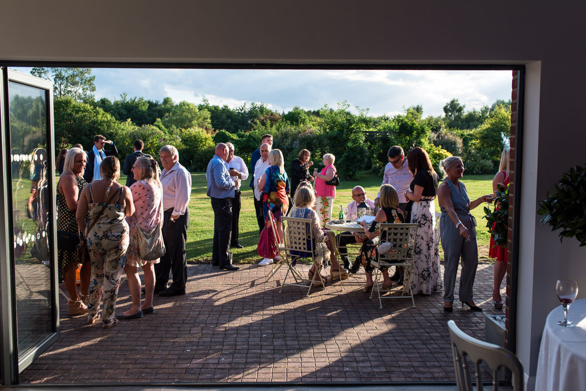 Photograph of the guests outside the barn at debbie and Martins wedding