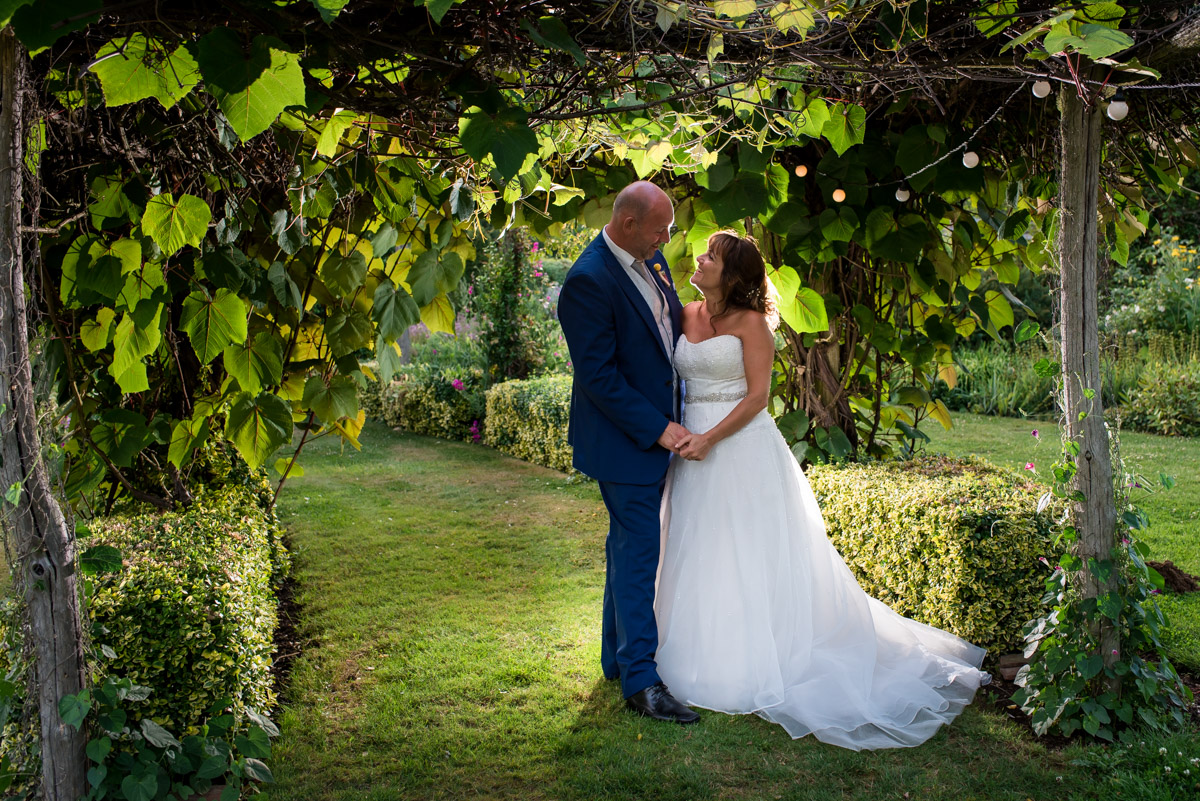 Photograph of Debbie and Martin in The Gardens Yalding on their wedding day