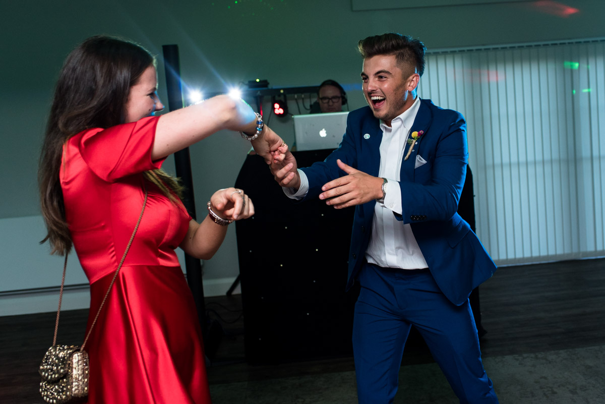 Photograph of guests dancing at The Gardens Yalding wedding venue in Kent